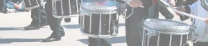 Bandmembers holding drums